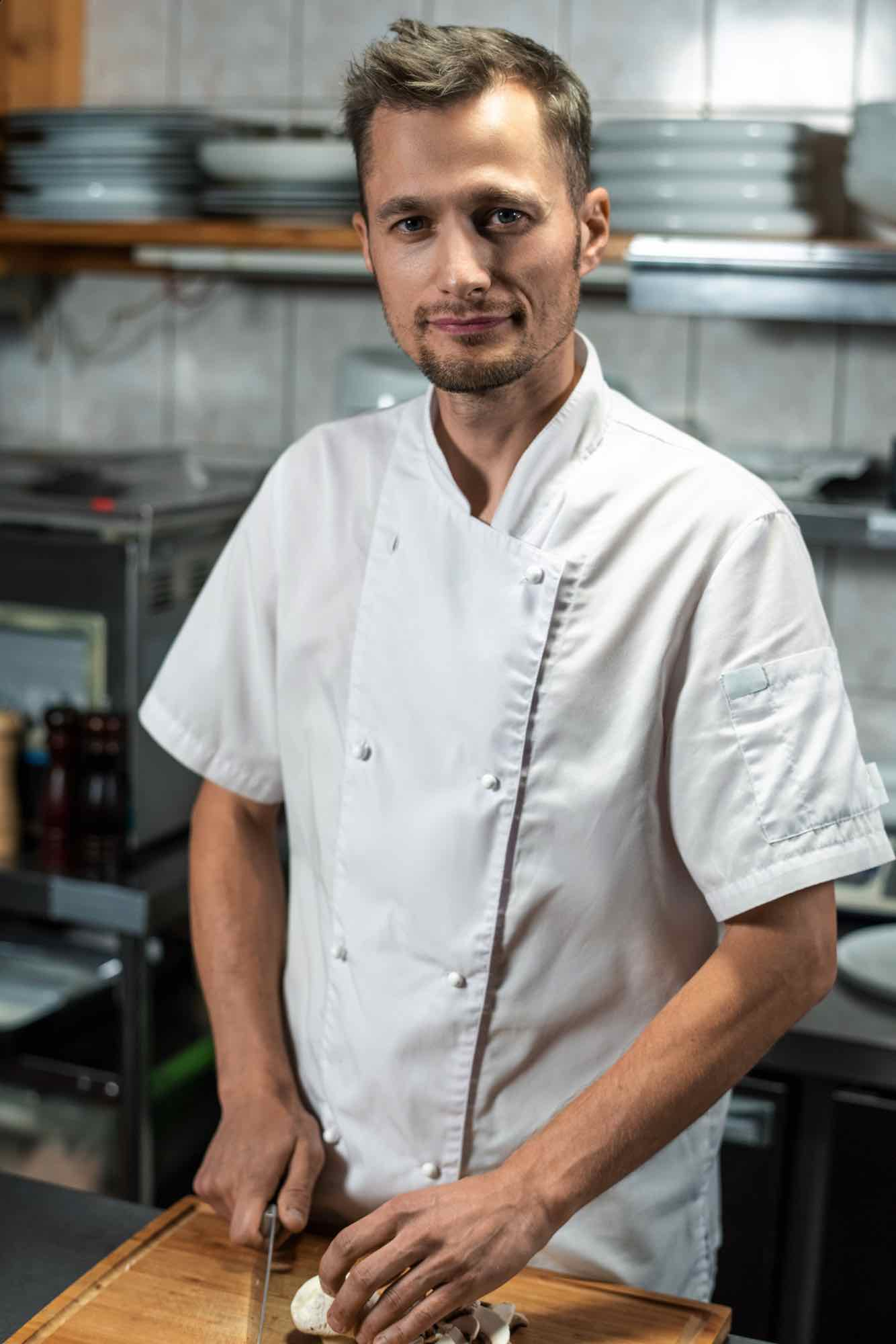 young-professional-male-chef-in-white-uniform-look-VATDR6J.jpg